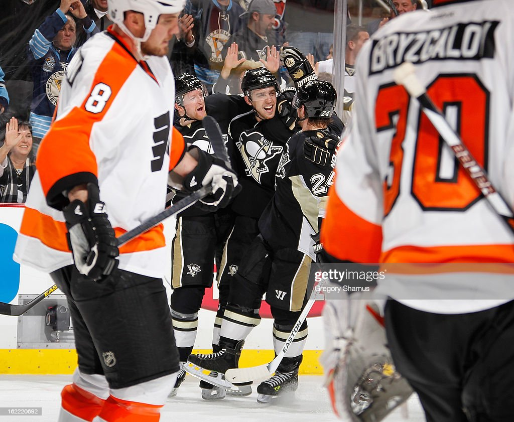 Brandon Sutter #16 of the Pittsburgh Penguins celebrates his goal with Paul Martin #7 and Matt Cooke #24 during the third period against the Philadelphia Flyers on February 20, 2013 at Consol Energy Center in Pittsburgh, Pennsylvania. Philadelphia won the game 6-5.