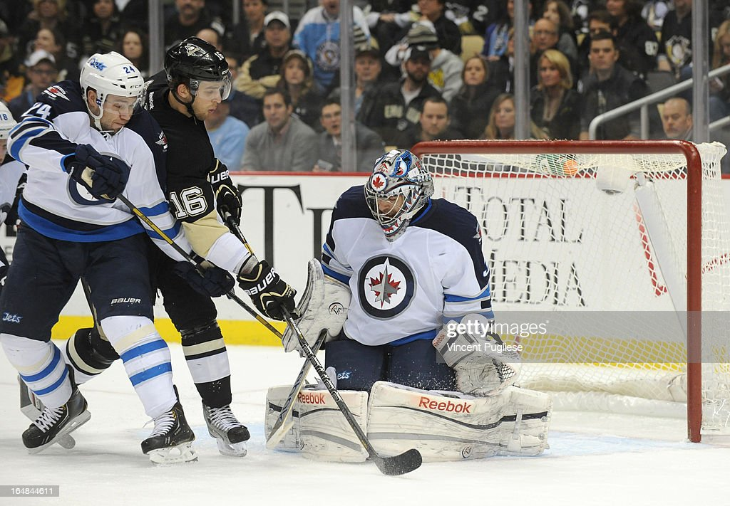Brandon Sutter #16 of the Pittsburgh Penguins deflects a shot on Al Montoya #35 of the Winnipeg Jets as Grant Clitsome #24 of the Jets defends in the first period on February 28, 2013 at the CONSOL Energy Center in Pittsburgh, Pennsylvania.