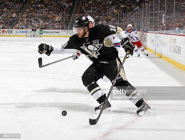 Brandon Sutter of the Pittsburgh Penguins moves the puck against the New York Rangers in Game Seven of the Second Round of the 2014 Stanley Cup...