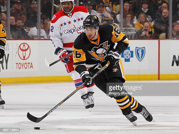 Brandon Sutter of the Pittsburgh Penguins moves the puck up ice during the second period against the Washington Capitals at Consol Energy Center on...
