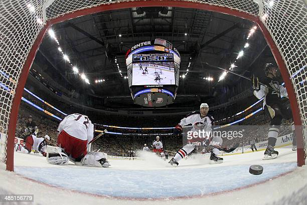 Brandon Sutter of the Pittsburgh Penguins scores past Sergei Bobrovsky of the Columbus Blue Jackets in the third period in Game One of the First...