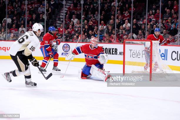 Brandon Sutter of the Pittsburgh Penguins shoots the puck past Carey Price of the Montreal Canadiens to score the game-winning goal in overtime...
