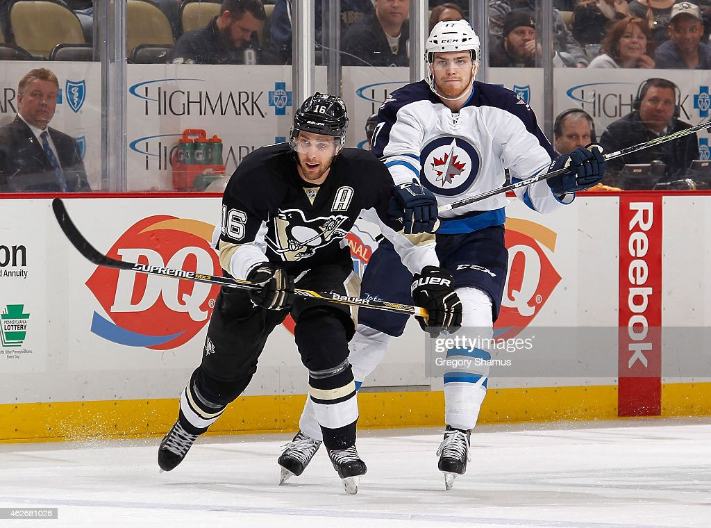 Brandon Sutter #16 of the Pittsburgh Penguins skates alongside Adam Lowry #17 of the Winnipeg Jets at Consol Energy Center on January 27, 2015 in Pittsburgh, Pennsylvania.