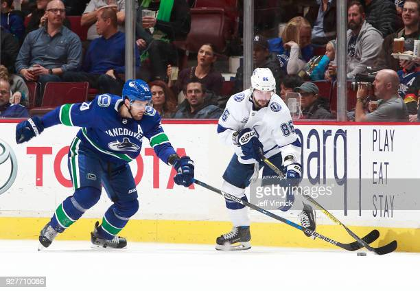Brandon Sutter of the Vancouver Canucks and Nikita Kucherov of the Tampa Bay Lightning watch the puck during their NHL game at Rogers Arena February...
