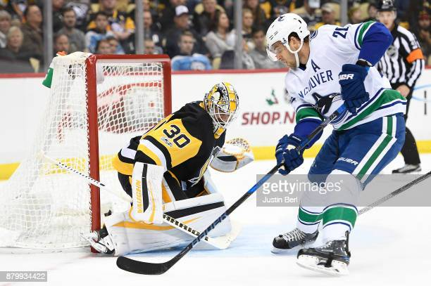 Brandon Sutter of the Vancouver Canucks attempts a shot on Matt Murray of the Pittsburgh Penguins in the first period during the game at PPG PAINTS...