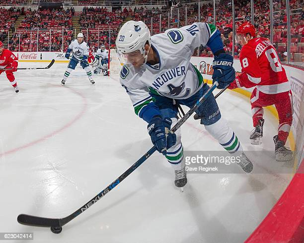 Brandon Sutter of the Vancouver Canucks controls the puck in the corner next to Justin Abdelkader of the Detroit Red Wings during an NHL game at Joe...