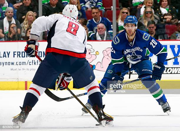 Brandon Sutter of the Vancouver Canucks looks on as Alex Ovechkin of the Washington Capitals skates up ice with the puck during their NHL game at...