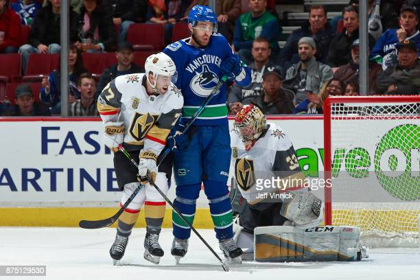 Brandon Sutter of the Vancouver Canucks looks on as Maxime Lagace of the Vegas Golden Knights blocks a shot during their NHL game at Rogers Arena...