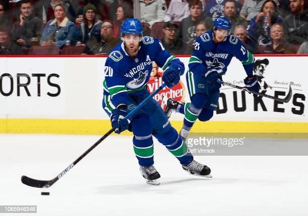 Brandon Sutter of the Vancouver Canucks passes the puck up ice during their NHL game against the Minnesota Wild at Rogers Arena October 29, 2018 in...