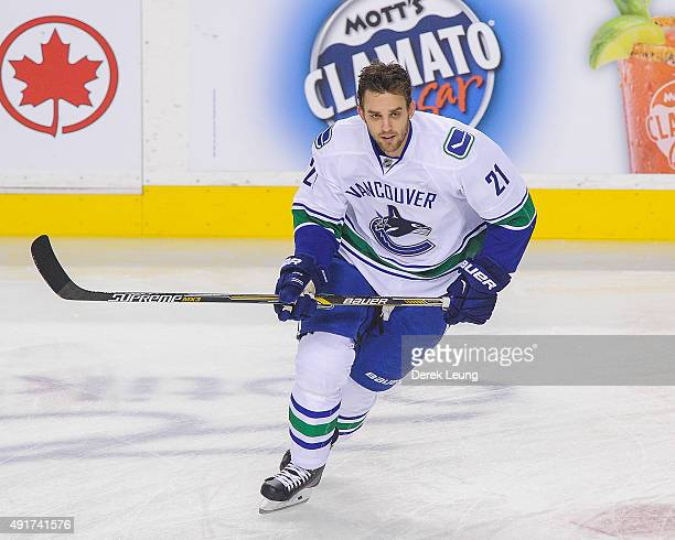 Brandon Sutter of the Vancouver Canucks skates during warmups in the NHL season opener at Scotiabank Saddledome on October 7 2015 in Calgary Alberta...