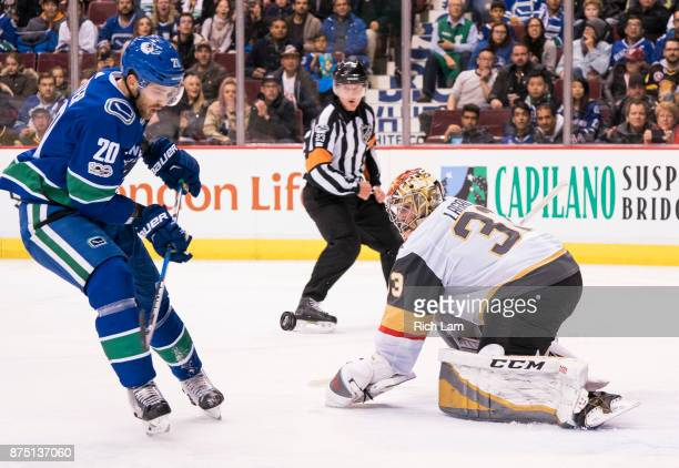 Brandon Sutter of the Vancouver Canucks tries to get his stick on the puck after getting stopped by goalie Maxime Lagace of the Vegas Golden Knights...