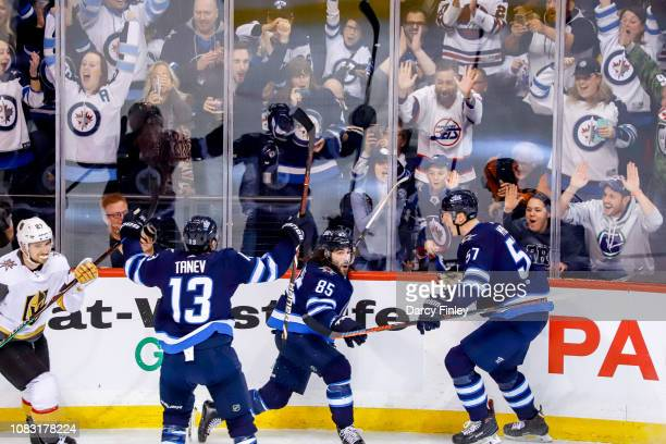 Brandon Tanev Mathieu Perreault and Tyler Myers of the Winnipeg Jets celebrate a second period goal against the Vegas Golden Knights at the Bell MTS...