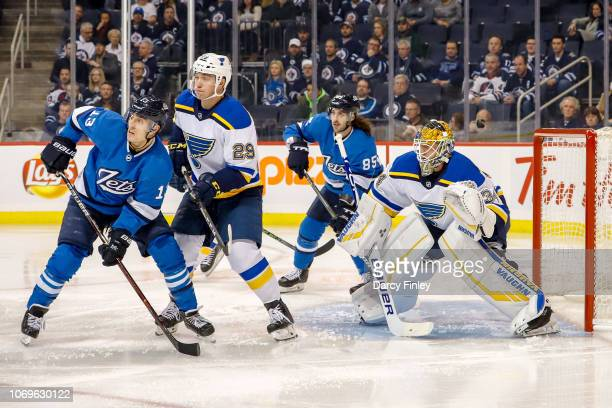 Brandon Tanev Mathieu Perreault of the Winnipeg Jets Vince Dunn and goaltender Jake Allen of the St Louis Blues keep an eye on the play during first...