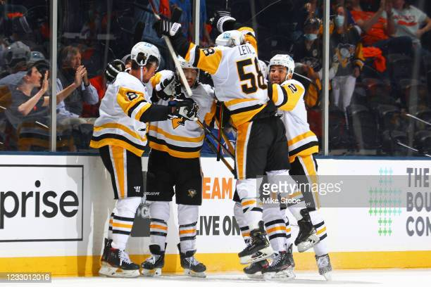 Brandon Tanev of the Pittsburgh Penguins is congratulated by his teammates after scoring a goal the eventual game-winning goal against the New York...