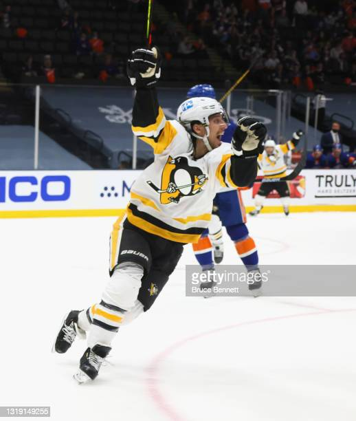 Brandon Tanev of the Pittsburgh Penguins scores the game winning goal at 16:24 of the third period against Semyon Varlamov of the New York Islanders...