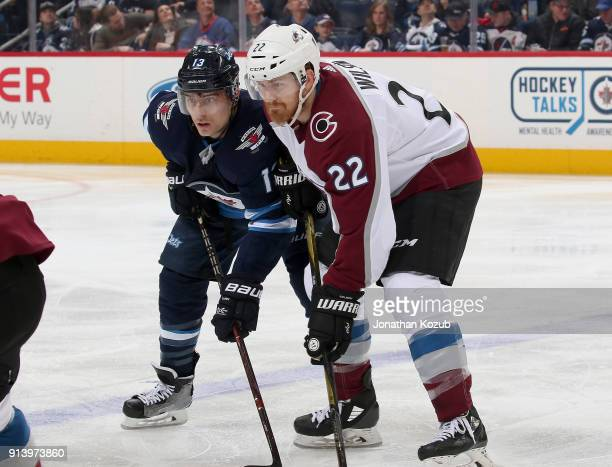 Brandon Tanev of the Winnipeg Jets and Colin Wilson of the Colorado Avalanche get set for a third period faceoff at the Bell MTS Place on February 3...
