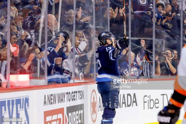 Brandon Tanev of the Winnipeg Jets celebrates after scoring a second period goal against the Philadelphia Flyers at the Bell MTS Place on December 9...