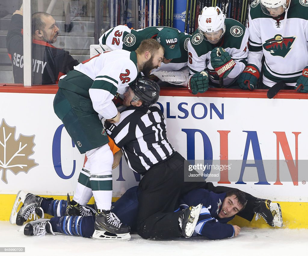 Brandon Tanev #13 of the Winnipeg Jets fights Daniel Winnik #26 of the Minnesota Wild in Game Two of the Western Conference First Round during the 2018 NHL Stanley Cup Playoffs on April 13, 2018 at Bell MTS Place in Winnipeg, Manitoba, Canada.
