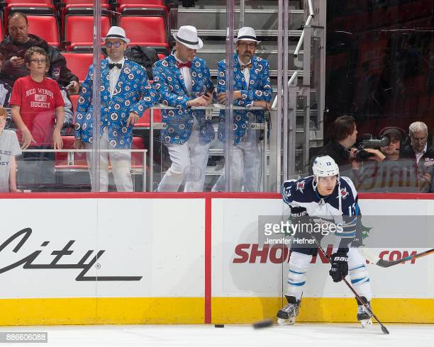 Brandon Tanev of the Winnipeg Jets follows the action during warmups as fans watch from the stands prior to an NHL game against the Detroit Red Wings...