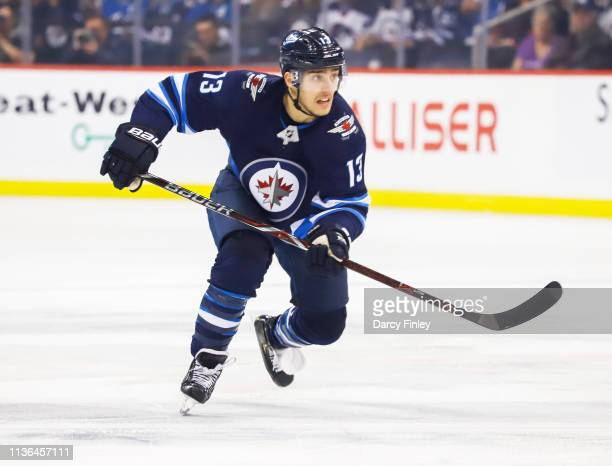 Brandon Tanev of the Winnipeg Jets follows the play down the ice during first period action against the San Jose Sharks at the Bell MTS Place on...
