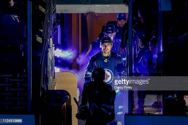 Brandon Tanev of the Winnipeg Jets heads to the ice prior to NHL action against the New York Rangers at the Bell MTS Place on February 12 2019 in...