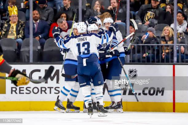 Brandon Tanev of the Winnipeg Jets joins teammates to celebrate a second period goal against the Vegas Golden Knights at TMobile Arena on February 22...