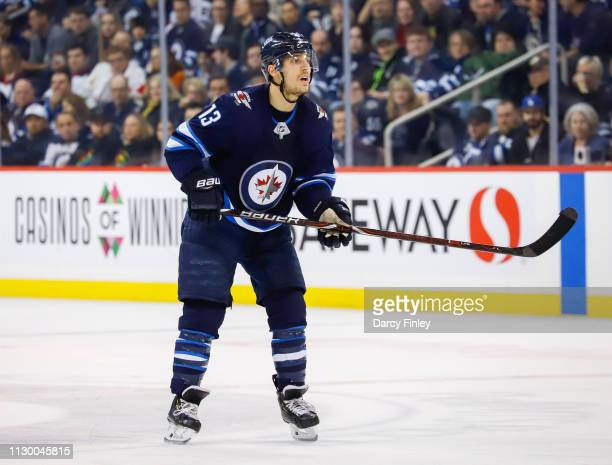 Brandon Tanev of the Winnipeg Jets keeps an eye on the play during third period action against the New York Rangers at the Bell MTS Place on February...