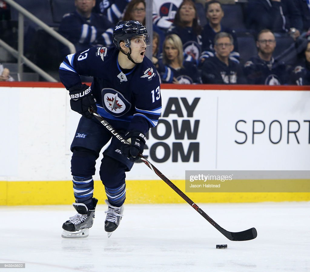 Brandon Tanev #13 of the Winnipeg Jets looks to pass during NHL action against the Chicago Blackhawks on April 7, 2018 at Bell MTS Place in Winnipeg, Manitoba.