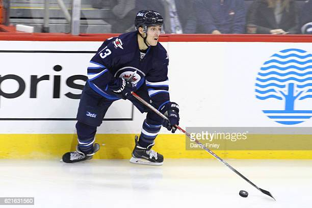 Brandon Tanev of the Winnipeg Jets plays the puck along the boards during second period action against the Washington Capitals at the MTS Centre on...