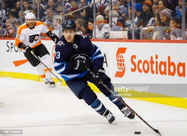 Brandon Tanev of the Winnipeg Jets plays the puck around the boards during first period action against the Philadelphia Flyers at the Bell MTS Place...