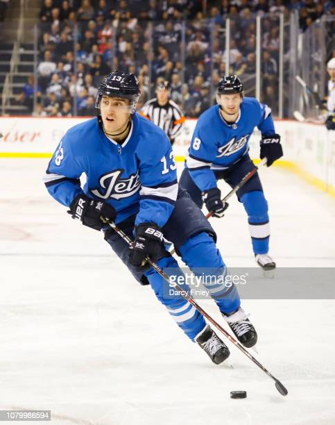 Brandon Tanev of the Winnipeg Jets plays the puck down the ice during second period action against the St Louis Blues at the Bell MTS Place on...