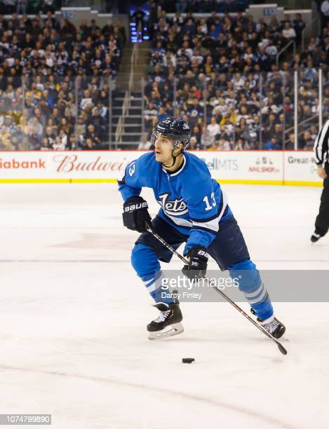 Brandon Tanev of the Winnipeg Jets plays the puck during second period action against the Pittsburgh Penguins at the Bell MTS Place on November 27...