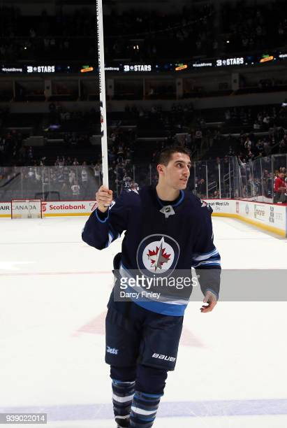 Brandon Tanev of the Winnipeg Jets salutes the fans after receiving first star honours following a 54 shootout victory over the Boston Bruins at the...