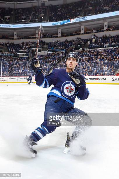 Brandon Tanev of the Winnipeg Jets takes part in the pregame warm up prior to NHL action against the Tampa Bay Lightning at the Bell MTS Place on...