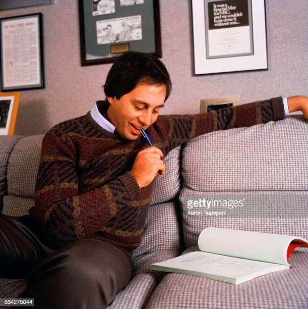 Brandon Tartikoff Reading on the Sofa