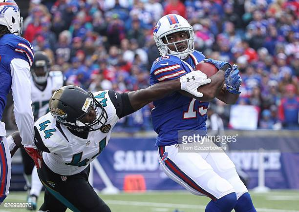 Brandon Tate of the Buffalo Bills returns a punt as Myles Jack of the Jacksonville Jaguars tries to tackle him during NFL game action at New Era...