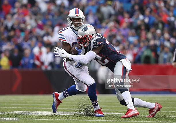Brandon Tate of the Buffalo Bills suffers a head injury as he is hit by Devin McCourty of the New England Patriots during NFL game action at New Era...