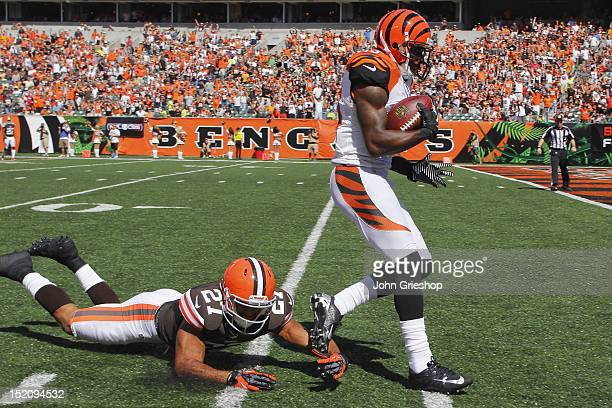 Brandon Tate of the Cincinnati Bengals avoids the tackle of Eric Hagg of the Cleveland Browns enroute to scoring a touchdown during their game at...