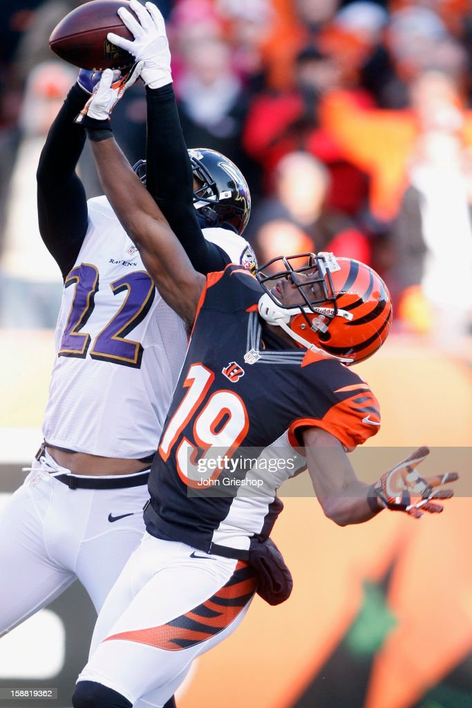 Brandon Tate #19 of the Cincinnati Bengals battles for the football with Jimmy Smith #22 of the Baltimore Ravens during their game at Paul Brown Stadium on December 30, 2012 in Cincinnati, Ohio. The Bengals defeated the Ravens 23-17.