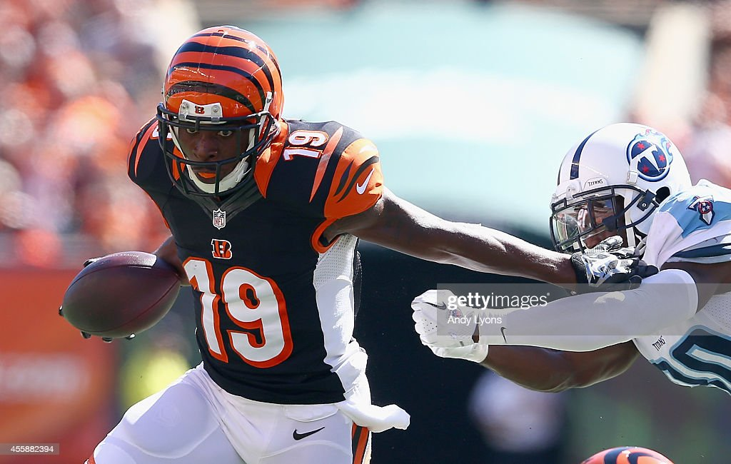 Brandon Tate #19 of the Cincinnati Bengals runs with the ball during the game against the Tennessee Titans at Paul Brown Stadium on September 21, 2014 in Cincinnati, Ohio.