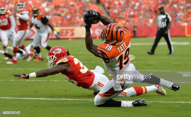 Brandon Tate of the Cincinnati Bengals scores a touchdown against Ron Parker of the Kansas City Chiefs during the first quarter at Arrowhead Stadium...