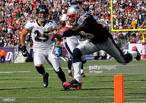 Brandon Tate of the New England Patriots gains yards against the defense of Chris Carr and Terrell Suggs of the Baltimore Ravens at Gillette Stadium...