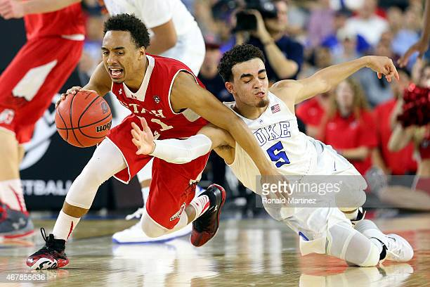 Brandon Taylor of the Utah Utes and Tyus Jones of the Duke Blue Devils dive for a loose ball in the second half during a South Regional Semifinal...