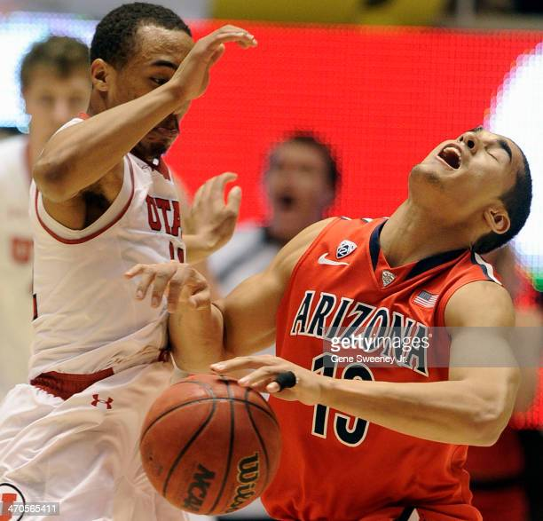 Brandon Taylor of the Utah Utes collides with Nick Johnson of the Arizona Wildcats during the second half of a game at the Jon M Huntsman Center...