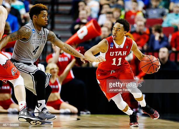 Brandon Taylor of the Utah Utes drives against D'Vauntes SmithRivera of the Georgetown Hoyas in the second half during the third round of the 2015...
