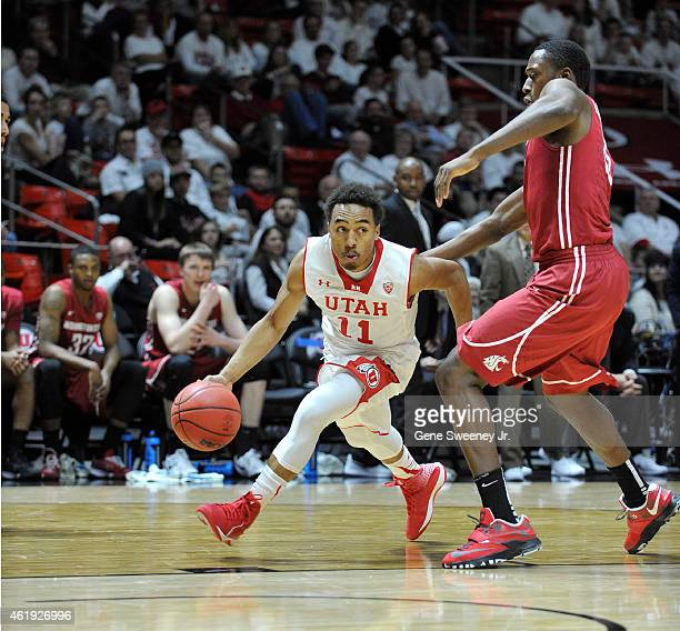 Brandon Taylor of the Utah Utes drives around Junior Longrus of the Washington State Cougars during first half action at the Jon M Huntsman Center on...