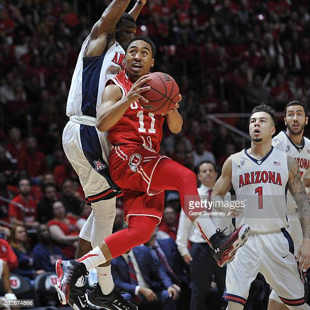 Brandon Taylor of the Utah Utes goes to the basket in front of Kadeem Allen of the Arizona Wildcats during the first half of their game at the Jon M...