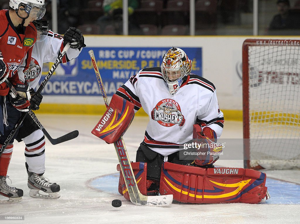 Brandon Thibeau #31 of the Weeks Crushers makes a save during the third period against the Summerside Western Capitals on November 25, 2012 at the Consolidated Credit Union Place in Summerside, Prince Edward Island, Canada.