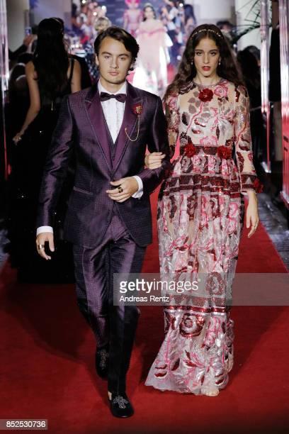 Brandon Thomas Lee and Coco K walk the runway at the Dolce Gabbana secret show during Milan Fashion Week Spring/Summer 2018 at Bar Martini on...