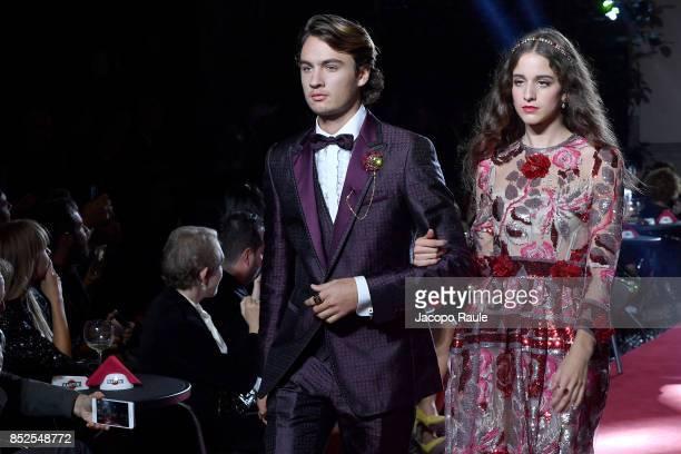 Brandon Thomas Lee and Coco Konig walk the runway at the Dolce Gabbana secret show during Milan Fashion Week Spring/Summer 2018 at Bar Martini on...